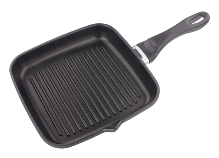 griller: Non stick ridged griddle pan isolated on a white background Stock Photo