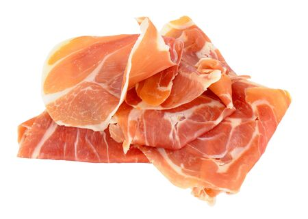thinly: Pile of thinly sliced Serrano ham isolated on a white background Stock Photo