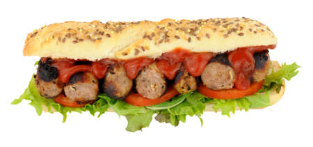 filled roll: Sausage filled sub roll sandwich with lettuce and tomatoes and tomato sauce isolated on a white background Stock Photo