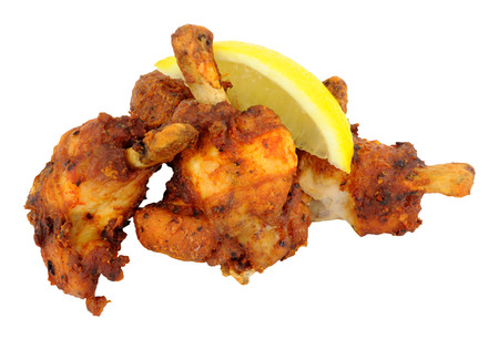 trimmed: Group of cooked trimmed chicken wings with lemon isolated on a white background