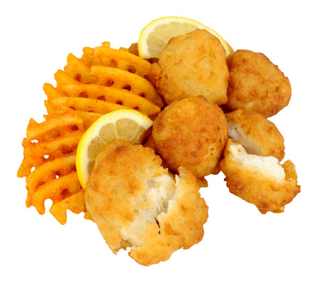 potato cod: Fried batter coated cod fish nuggets with lattice potato fries isolated on a white background