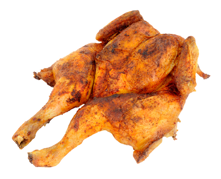 Whole roasted flat spatchchcock chicken isolated on a white background