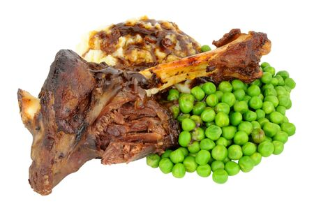 lamb shank: Slow cooked lamb shank meal with mashed potato and peas isolated on a white background