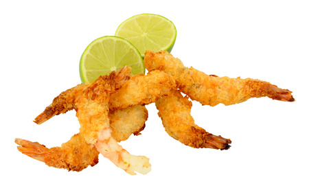 crispy: Coconut and batter coated prawns with fresh lime isolated on a white background Stock Photo