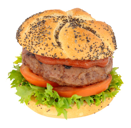 filled out: Beef burger with lettuce and tomato in a seed covered bread roll isolated on a white background