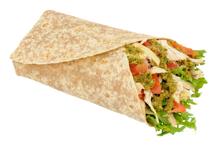 tortilla wrap: Chicken and salad in a tortilla wrap with basil herb pesto isolated on a white background Stock Photo