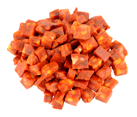 peppery: Pile of chopped spicy chorizo salami isolated on a white background