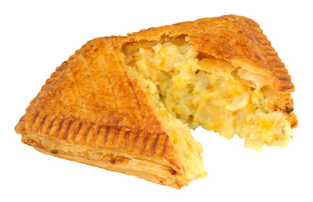 savoury: Cheese and onion filled puff pastry savoury slice isolated on a white background