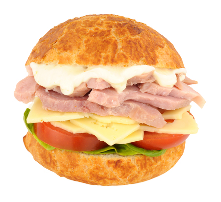 chunky: Chunky ham and cheese sandwich in a crusty bread roll with lettuce and tomato isolated on a white background
