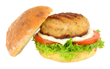 crusty: Chicken burger with salad and mayonnaise in a crusty bread roll isolated on a white background Stock Photo