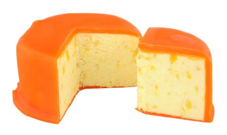 stilton: Orange wax covered mango and ginger Stilton cheese isolated on a white background