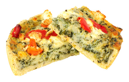 Spinach and feta cheese quiche with roasted peppers isolated on a white background