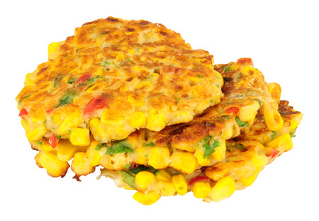 Fried sweetcorn and chilli pepper fritters isolated on a white background Stock Photo