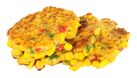 Fried sweetcorn and chilli pepper fritters isolated on a white background Archivio Fotografico