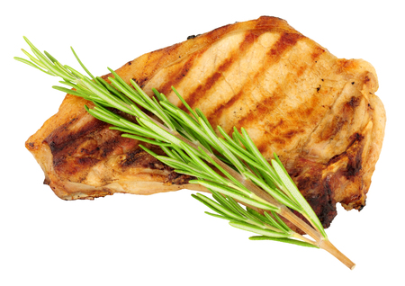 grilled pork chop: Grilled pork chop isolated on a white background Stock Photo