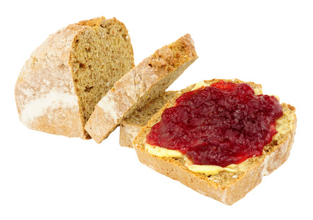 crusty: Buttered crusty bread with strawberry jam isolated on a white background
