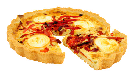 Goats cheese and red pepper quiche isolated on a white background