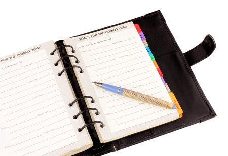 personal organiser: Open personal organiser with fountain pen isolated on white