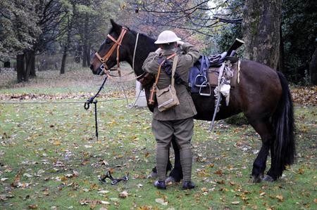British world war one cavalry soldier preparing horse