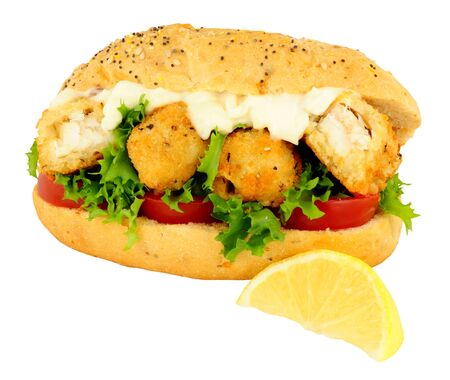 Fish finger and salad filled sandwich roll isolated on a white background