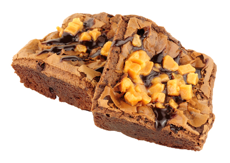 Two chocolate and caramel fudge brownies isolated on a white background