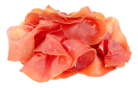 Traditional Italian Bresaola dry cured beef slices isolated on a white background