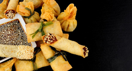 Group of mixed Oriental pastry wrapped snacks on a slate background Stock Photo