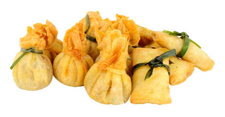 filled roll: Group of mixed Oriental pastry wrapped snacks isolated on a white background