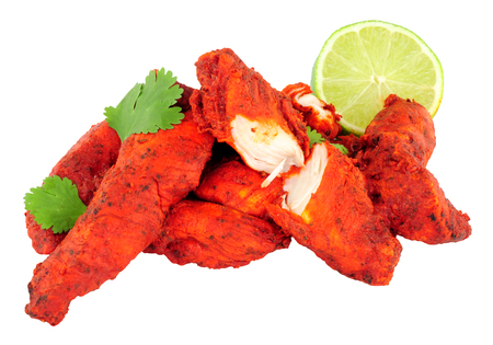 Cooked tandoori chicken fillets isolated on a white background