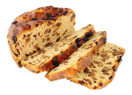 Traditional Irish Barmbrack sweet fruit bread loaf isolated on a white background