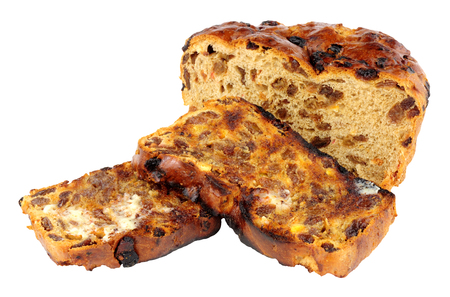 sultanas: Toasted Irish barmbrack sweet bread slices with butter isolated on a white background Stock Photo