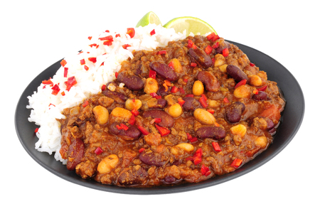 peppery: Chilli Con Carne with boiled rice on a black plate isolated on a white background