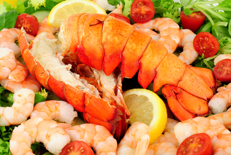 crustaceans: Cooked lobster tails with a fresh salad background Stock Photo
