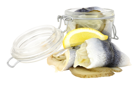 Pickled rollmop herrings in a glass storage jar isolated on a white background Banco de Imagens