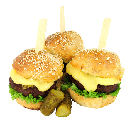 Group of cheeseburger sliders with melted cheese isolated on a white background Stock Photo