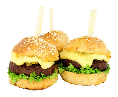 filled roll: Group of cheeseburger sliders with melted cheese isolated on a white background Stock Photo