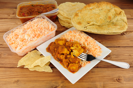 Indian curry take away meal with poppadoms and nan bread Stock Photo