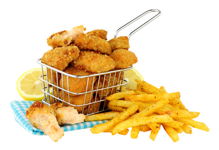 Breadcrumb fried scampi in a small wire frying basket with French fries isolated on  a white background Stock Photo