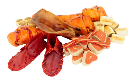 Group of assorted dog chews and treats isolated on a white background