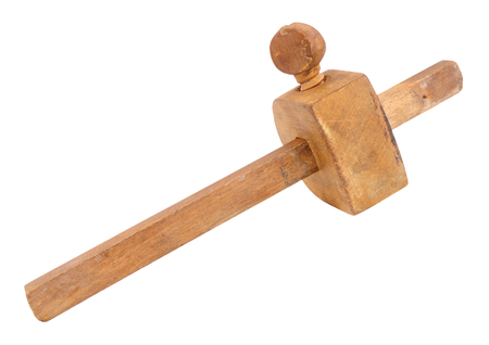 Old woodworking marker gauge tool isolated on a white background