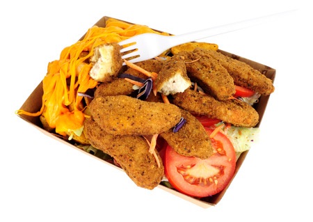 Southern fried chicken fillets and cheesy potato wedges in a cardboard take away tray isolated on a white background