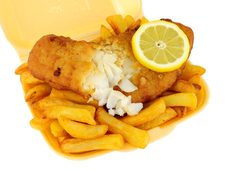 Fish and chips in a polystyrene take away tray isolated on a white background