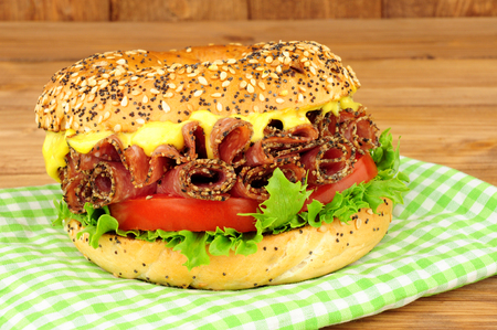 German peppered salami and salad filled bagel sandwich with mayonnaise