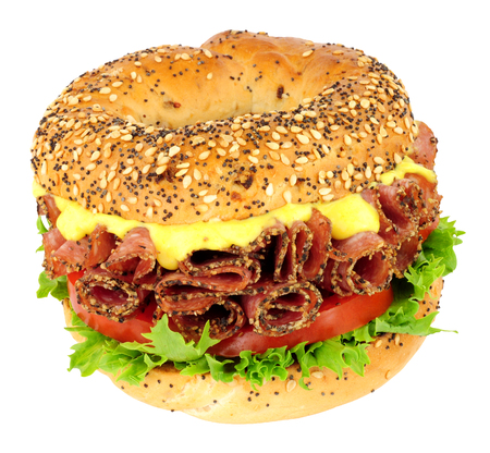 Peppered salami and salad bagel sandwich isolated on a white background Stock Photo