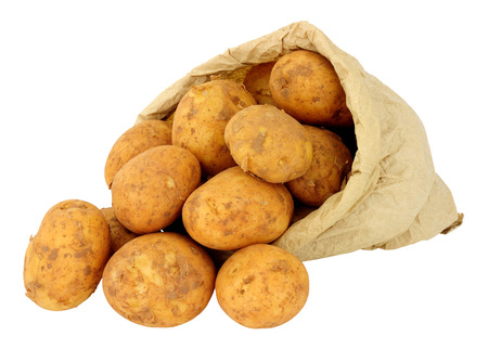 Fresh new potatoes in a brown paper bag isolated on a white background Stockfoto