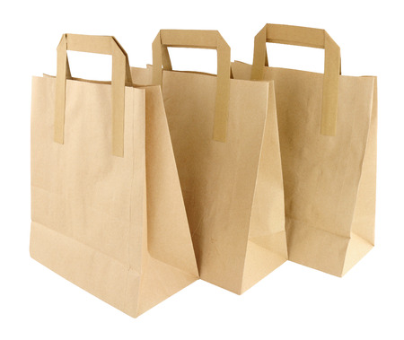 Three plain brown paper take away food carrier bags with handles isolated on a white background