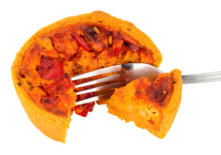 Chorizo and manchego cheese filled savoury quiche isolated on a white background
