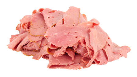 Pile of thinly sliced pastrami meat isolated on a white background