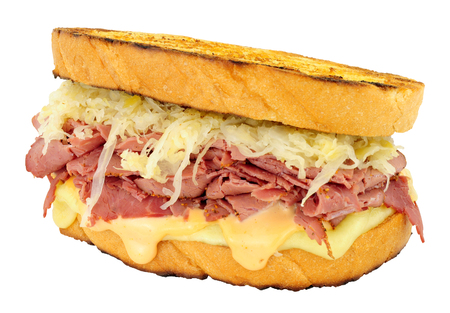 Pastrami Reuben style sandwich with sauerkraut and Swiss cheese isolated on a white background Stockfoto