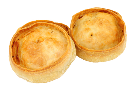 Traditional Scotch meat pies isolated on a white background Фото со стока